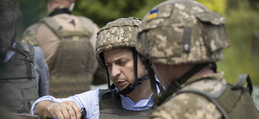 Ukrainian President Volodymyr Zelenskiy talks with servicemen as he visits the war-hit Luhansk region, eastern Ukraine, Monday, May 27, 2019.