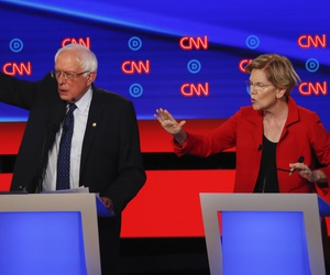 Sen. Bernie Sanders, I-Vt., and Sen. Elizabeth Warren, D-Mass., talk during in the first of two Democratic presidential primary debates hosted by CNN Tuesday, July 30, 2019, in the Fox Theatre in Detroit.