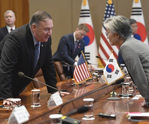Secretary of State Mike Pompeo, left, talks with South Korean Foreign Minister Kang Kyung-wha before the start of a meeting with President Donald Trump and South Korean President Moon at the Blue House in Seoul, Sunday, June 30, 2019.