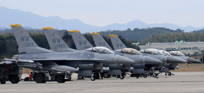 Five F-16 Fighting Falcons are positioned on the flightline at  Japan's Tsuiki Air Base.