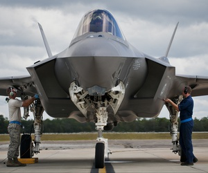 Airmen from the 33rd Maintenance Group perform checks on an F-35A Lightning II prior to a hot pit refueling session at Eglin Air Force Base, Florida.