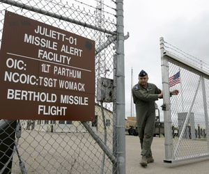 An airman closes the gate at an ICBM launch control facility outside Minot, N.D.