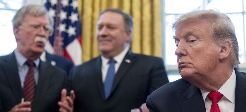 From left, National Security Adviser John Bolton, accompanied by Secretary of State Mike Pompeo, and President Donald Trump, at the White House in Washington, Thursday, Feb. 7, 2019.