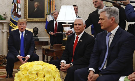 Then-presidential envoy Robert O'Brien, right, attends an Oval Office press conference with President Donald Trump in March 2019. At back, to the right of Trump, is national security adviser John Bolton.