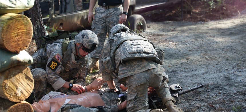 U.S. Army Rangers, 1st Lt. Jonathan Brege and 1st. Lt. Jeffrey Ivas, prepare to evacuate a dummy during the Best Ranger Competition on Fort Benning, Ga., April 12, 2014