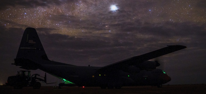 A C-130J Super Hercules, assigned to the 75th Expeditionary Airlift Squadron, sits on the taxiway while cargo is unloaded in Somalia, on August 25, 2019.