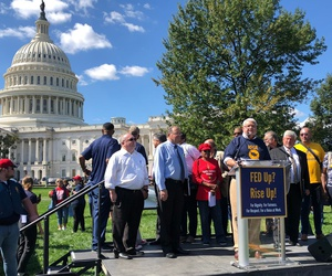 """""""Any attempts by agencies to enforce these provisions outside of the collective bargaining process will be met with immediate legal challenge by the union,"""" warned J. David Cox, AFGE's president. Cox, above, speaks at a union rally in late September."""