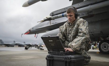 Staff Sgt. Zackery Coder checks computer data during Red Flag-Alaska 14-2, June 19, 2014, on Eielson Air Force Base, Alaska.