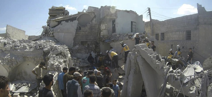 Syrian White Helmet civil defense workers search for victims from under the rubble of a destroyed building that hit by a Syrian government airstrike, in the northern town of Ariha, in Idlib province, Syria, on July 12, 2019.
