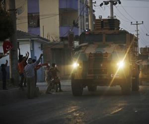 A convoy of Turkish forces vehicles drives through the town of Akcakale, at the border between Turkey and Syria, shortly after Turkey's new ground offensive began, Wednesday, Oct. 9, 2019.