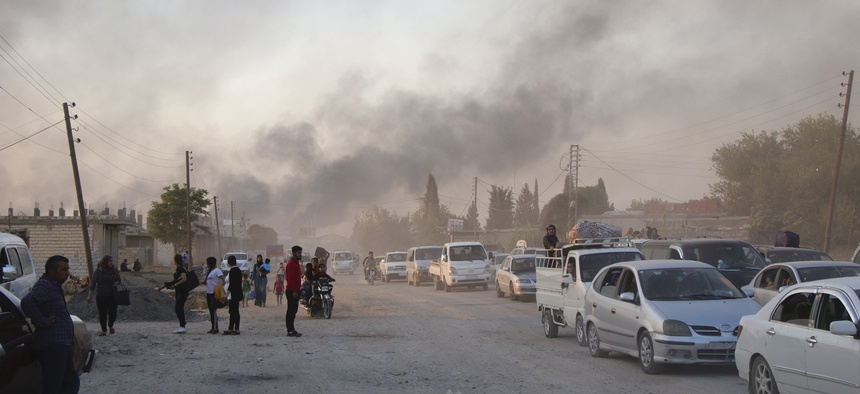 Syrians flee shelling by Turkish forces in Ras al Ayn, northeast Syria, Wednesday, Oct. 9, 2019.