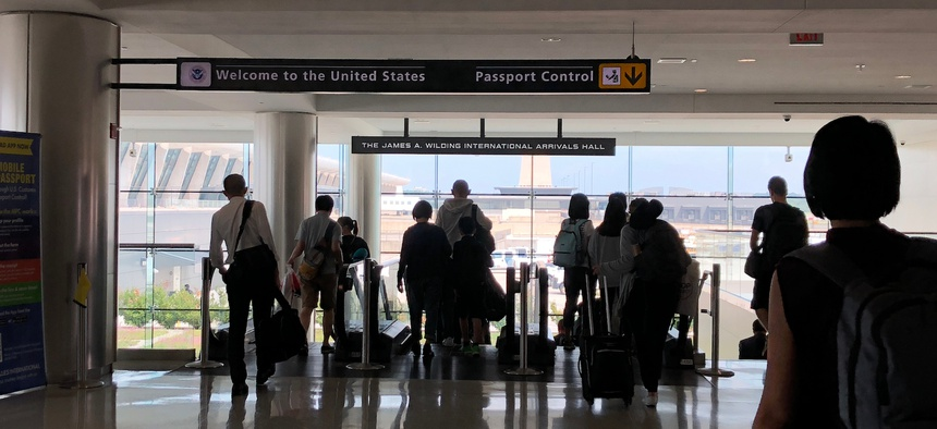 Passengers head for U.S. passport control at Dulles International Airport in a 2018 photo.