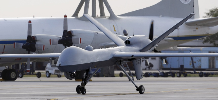 A Predator B unmanned aircraft taxis at the Naval Air Station, Tuesday, Nov. 8, 2011, in Corpus Christi, Texas.