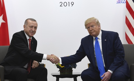President Donald Trump, right, shakes hands with Turkish President Recep Tayyip Erdogan, left, during a meeting on the sidelines of the G-20 summit in Osaka, Japan, Saturday, June 29, 2019.