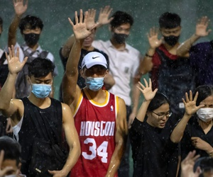 A demonstrator wearing Houston Rockets jersey holds up his hand with fellow demonstrators during a rally Hong Kong, Oct. 15,  after Houston Rockets general manager Daryl Morey's tweet in support of the Hong Kong protests sparked controversy in China.
