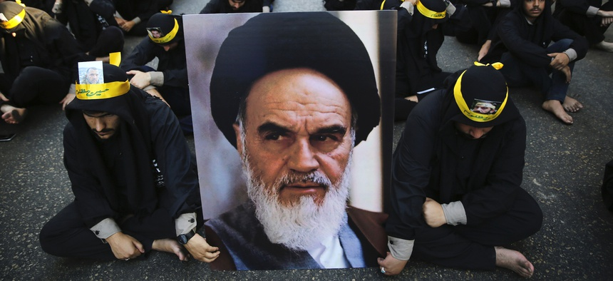 Lebanese supporters of Iran-backed Hezbollah hold a portrait of Iranian supreme leader Ayatollah Ali Khamenei during the holy day of Ashoura in a southern suburb of Beirut, Lebanon, Tuesday, Sept. 10, 2019.