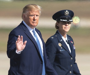 President Donald Trump waves as he walk towards Air Force One for a trip to Pittsburgh, Wednesday, Oct. 23, 2019, at Andrews Air Force Base, Md.