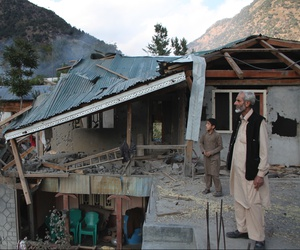 Pakistani Kashmiri residents look at the destruction reportedly caused by artillery fired by Indian forces in Neelum Valley along the Line of Control in Pakistani Kashmir, Monday, Oct. 21, 2019.