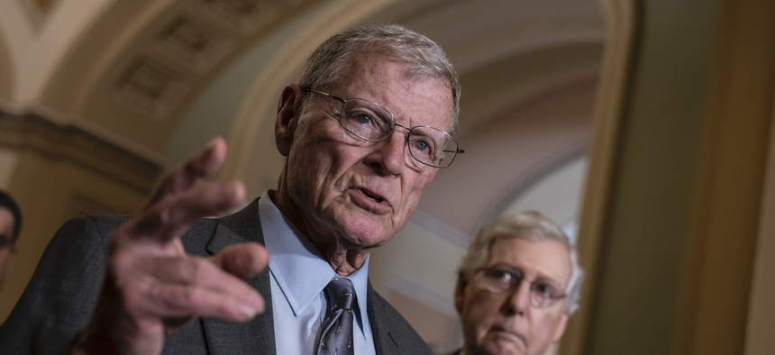 Senate Armed Services Committee Chairman Jim Inhofe, R-Okla., joined at right by Senate Majority Leader Mitch McConnell, R-Ky., speak to reporters on Capitol Hill in June 2019.