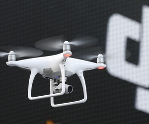 A Phantom 4, developed by major Chinese consumer-drone maker DJI, flies during its demonstration flight in Tokyo, Thursday, March 3, 2016.