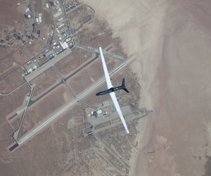 A Global Hawk flies over Edwards Air Force Base.