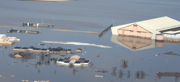 This March 17, 2019 photo released by the U.S. Air Force shows an aerial view of Offutt Air Force Base and the surrounding areas affected by flood waters in Nebraska.