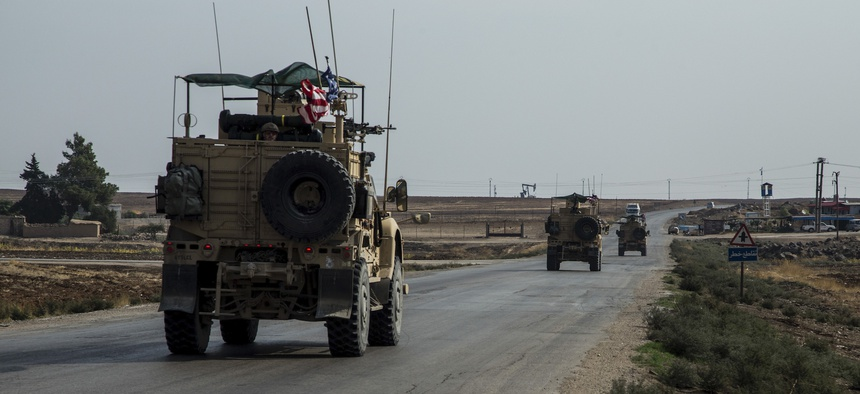In this Monday, Oct. 28, 2019 photo, U.S. forces patrol Syrian oil fields.