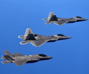 F-22 Raptors from the 94th Fighter Squadron, Joint Base Langley-Eustis, Va., and F-35A Lightning IIs from the 58th Fighter Squadron, Eglin Air Force Base, Fla., fly in formation after completing an integration training mission.