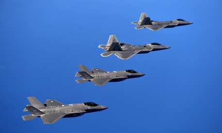 F-22 Raptors from the 94th Fighter Squadron, Joint Base Langley-Eustis, Virginia, and F-35A Lightning IIs from the 58th Fighter Squadron, Eglin Air Force Base, Florida, over the Eglin Training Range, Florida, Nov. 5, 2014.