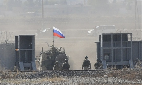 In this photo taken from the outskirts of Suruc, southeastern Turkey, Russian and Turkish forces enter Syria, as they begin their joint patrol, Tuesday, Nov. 5, 2019.