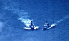 On June 7, 2019, the U.S. Navy cruiser Chancellorsville, right, was forced to maneuver to avoid collision from the approaching Russian destroyer Udaloy I in the Philippine Sea.