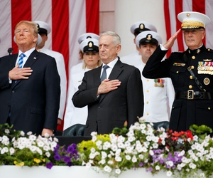 "President Donald Trump, Secretary of Defense Jim Mattis, and Chairman of the Joint Chiefs of Staff Gen. Joseph Dunford, stand for ""Taps"" during a Memorial Day ceremony at Arlington National Cemetery in 2018."