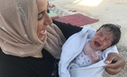 Batoul and her baby in 2017, shortly after they fled the ISIS capital of Raqqa, Syria..