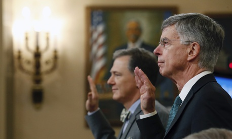 Top U.S. diplomat in Ukraine William Taylor, right, and career Foreign Service officer George Kent, left are sworn in to testify before the House Intelligence Committee on Capitol Hill in Washington, Wednesday, Nov. 13, 2019.