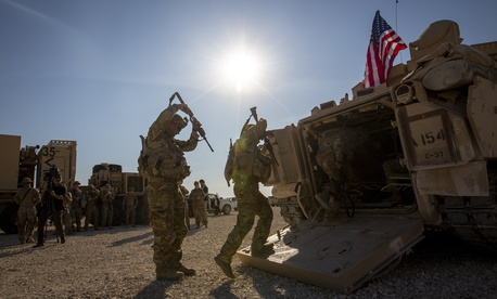 Crewmen enter Bradley fighting vehicles at a US military base in northeastern Syria, Monday, Nov. 11, 2019.