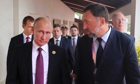 This Nov. 10, 2017, file photo shows Russia's President Vladimir Putin, left, and Russian metals magnate Oleg Deripaska, right, walking to attend the APEC Business Advisory Council dialogue in Danang, Vietnam.