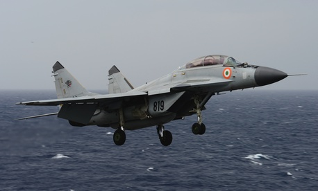 "An Indian navy MIG-29K ""Fulcrum"" flies over the aircraft carrier USS Nimitz (CVN 68) during Exercise Malabar 2017."