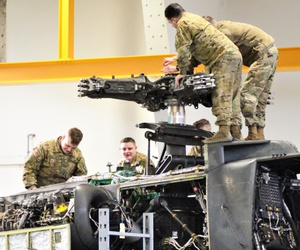 Soldiers conduct 500 hours phase maintenance on an AH-64 Apache helicopter at Katterbach Army Airfield, Germany, Nov. 14.