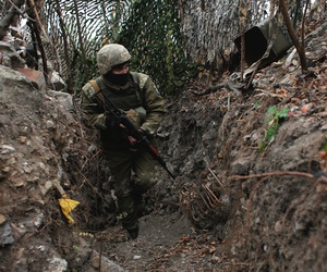 In this photo taken on Monday, Nov. 18, 2019, a Ukrainian soldier in a trench in the front line near the town of Avdiivka in the Donetsk region, Ukraine.