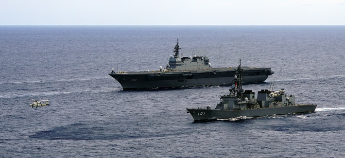 In this June 28, 2019, photo, Japan's Maritime Self-Defense Force helicopter carrier Izumo (DDH-183) and destroyer JS Murasame (DD-101) participate in drills that included maritime navigation and emergency response exercises in Sulu Sea.
