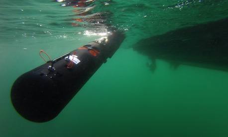 U.S. and Italian sailors deploy a Remote Environmental Measuring Units (REMUS) 100 unmanned underwater vehicle off Sesimbra, Portugal, Sept. 19, 2019.