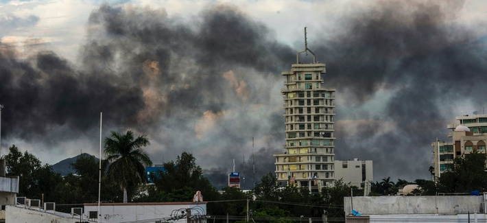 This Oct. 17, 2019, photo shows clouds of smoke from burning cars mar the skyline of Culiacan, Mexico. The Mexican city lived under drug cartel terror for 12 hours as gang members forced the government to free a drug lord.