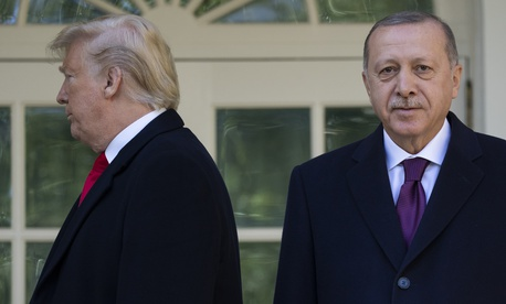 President Donald Trump walks off toward the Oval Office after posing for photographers with Turkish President Recep Tayyip Erdogan before a meeting in the Oval Office of the White House, Wednesday, Nov. 13, 2019.