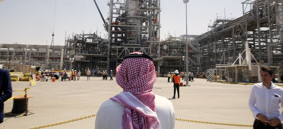 In this photo opportunity during a trip organized by Saudi information ministry, a man stands in front of the Khurais oil field in Khurais, Saudi Arabia, Friday, Sept. 20, 2019, after it was hit during Sept. 14 attack.