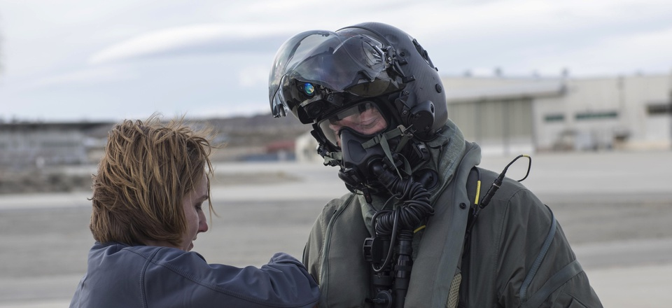 Marine Corps Maj. Douglas Rosenstock, 461st Flight Test Squadron, is inspected by contractor Dr. Angela Theys during a chemical/biological pilot ensemble test Jan. 6 at Edwards Air Force Base, California.