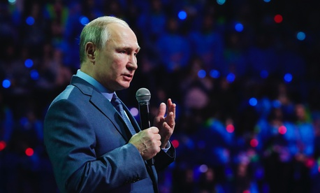Russian President Vladimir Putin speaks during the International Volunteer Forum at the Olympic Park in Sochi, Russia, Dec. 5, 2019.