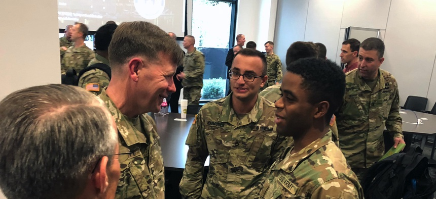 Lt. Gen. Stephen G. Fogarty, commander of Army Cyber Command, talks with soldiers in Augusta, Georgia, for the launch of a partnership with the Defense Digital Service at the Georgia Cyber Center in 2018. Lt. Gen. Stephen G. Fogarty, commander of Army Cyb