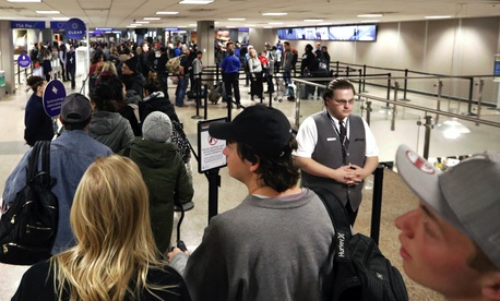 In this Wednesday, Nov. 27, 2019, file photo, travelers walk through a security checkpoint in Terminal 2 at Salt Lake City International Airport, in Salt Lake City.