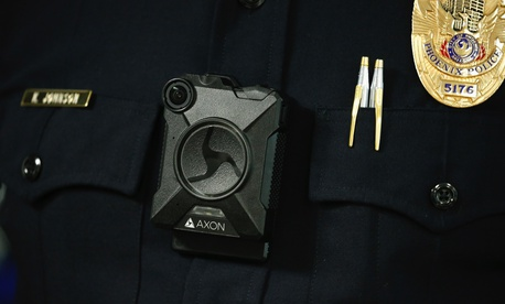 Phoenix Police Department Sgt. Kevin Johnson shows off the new Axon Body 2 body camera as another precinct gets their cameras assigned to them Wednesday, July 3, 2019, in Phoenix.