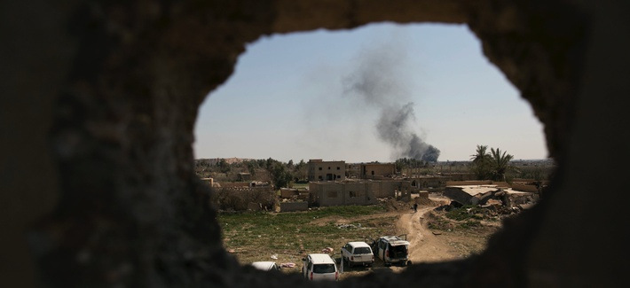 Smoke rises over Islamic State-held Baghouz, the last territory held by the militants in Syria, as U.S.-backed Syrian Democratic Forces (SDF) pound the area with air strikes and artillery on Monday, March 11, 2019.